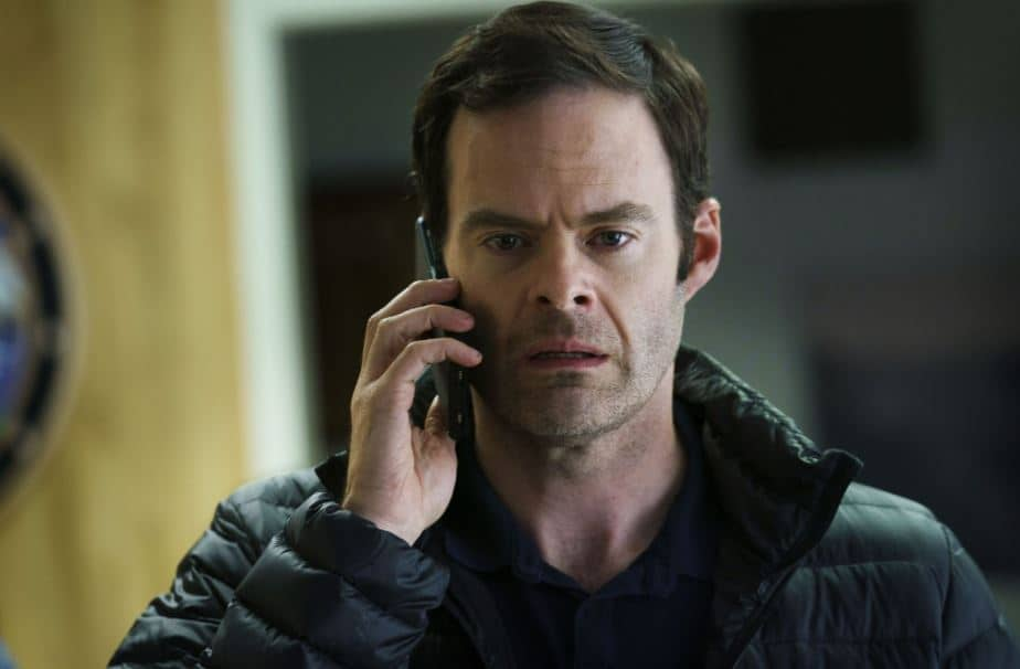 Barry looking stunned while talking someone on the phone in Barry Season 3
